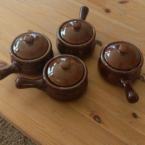 Brown ceramic crock bowl with handle and lid